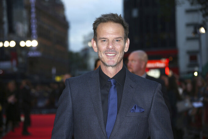 "FILE - In this Sept. 26, 2016 file photo, actor and director Peter Berg poses for photographers upon arrival at the premiere of the film ""Deepwater Horizon"" in London. Berg directed a new Super Bowl commercial called ""The 100-Year Game"" that paid homage to past and present NFL players including Tom Brady, Jim Brown, Joe Montana, Dick Butkus, Deion Sanders and Patrick Mahomes. The 2-minute ad will air during Super Bowl 53 on Sunday, Feb. 3, 2019. (Photo by Joel Ryan/Invision/AP, File)"