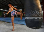 In this Wednesday, Nov. 14, 2018, photo, Thai kickboxer Chaichana Saengngern, 10-years old, practices kicks at a training camp in Bangkok, Thailand. Thai lawmakers recently suggested barring children younger than 12 from competitive boxing, but boxing enthusiasts strongly oppose the change. They say the sport is part of Thai culture and gives poor families the opportunity to raise a champion that will lift their economic circumstances. (AP Photo/Sakchai Lalit)