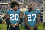 Jacksonville Jaguars cornerback Jalen Ramsey (20) talks to running back Leonard Fournette (27) before an NFL football game against the Tennessee Titans Thursday, Sept. 19, 2019, in Jacksonville, Fla. (AP Photo/Phelan M. Ebenhack)