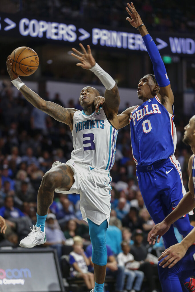 Charlotte Hornets guard Terry Rozier III, left, drives to the basket past Philadelphia 76ers guard Josh Richardson in the second half of a preseason NBA basketball game in Winston-Salem, N.C., Friday, Oct. 11, 2019. (AP Photo/Nell Redmond)