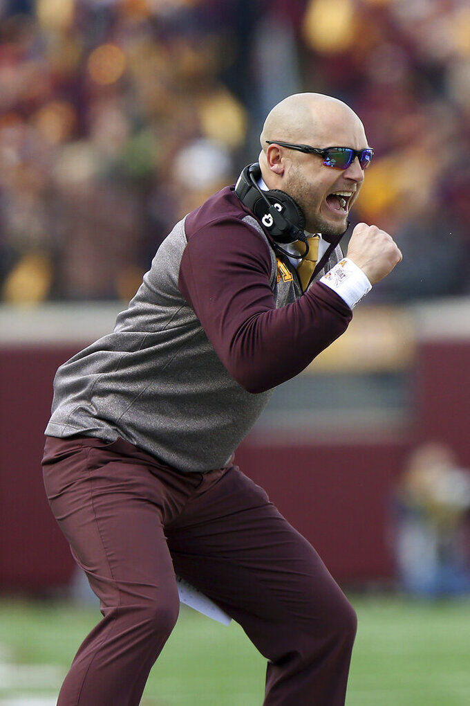 FILE - In this Nov. 9, 2019, photo, Minnesota head coach P.J. Fleck cheers his team during an NCAA college football game against Penn Staten in Minneapolis. Fans of Minnesota's Golden Gophers are enjoying football success the team hasn't seen in decades, and daring to dream of a trip to Pasadena. (AP Photo/Stacy Bengs,File)