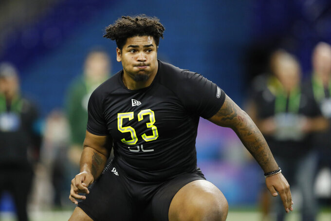 FILE - In this Feb. 28, 2020, file photo, Iowa offensive lineman Tristan Wirfs runs a drill at the NFL football scouting combine in Indianapolis. Wirfs was selected by the Tampa Bay Buccaneers in the first round of the NFL draft. (AP Photo/Charlie Neibergall, File)