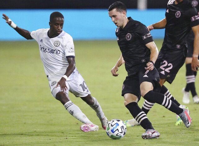 Inter Miami's Lewis Morgan (7) controls the ball in front of Philadelphia Union's Jamiro Montiero (10) during an MLS soccer match Tuesday, July 14, 2020, in Kissimmee, Fla. (Stephen M. Dowell/Orlando Sentinel via AP)