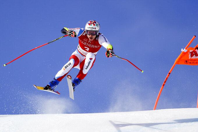 Switzerland's Marco Odermatt speeds down the course during an alpine ski, men's World Cup Super-G, in Kitzbuehel, Austria, Monday, Jan. 25, 2021. (AP Photo/Marco Trovati)