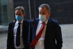 British Brexit negotiator David Frost, right, arrives for a meeting with European Commission's Head of Task Force for Relations with the United Kingdom Michel Barnier at EU headquarters in Brussels, Monday, Oct. 12, 2020. (AP Photo/Francisco Seco)