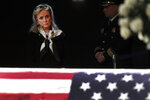 Rep. Debbie Dingell, D-Mich., stands at the casket of her husband and former Rep. John Dingell, lying in repose in Dearborn, Mich., Monday, Feb. 11, 2019. John Dingell, the longest-serving member of Congress in American history, was first elected in 1955 and retired in 2014. The Democrat was 92. (AP Photo/Paul Sancya)