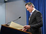 California Gov. Gavin Newsom prepares to sign an executive order to withdraw most of the National Guard troops from the nation's southern border and changing their mission, during a Capitol news conference Monday, Feb. 11, 2019, in Sacramento, Calif. (AP Photo/Rich Pedroncelli)