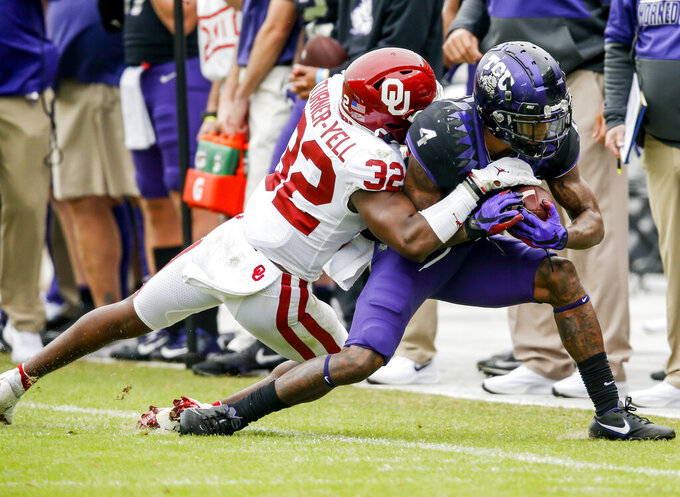Oklahoma safety Delarrin Turner-Yell (32) tackles TCU wide receiver Taye Barber (4) during the second half of an NCAA college football game, Saturday, Oct. 24, 2020, in Fort Worth, Texas. (AP Photo/Brandon Wade)