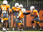 Tennessee defensive back Bryce Thompson (20) goes through a drill with Tennessee defensive back Shawn Shamburger, right, during NCAA college football practice Wednesday, Sept. 11, 2019 in Knoxville, Tenn. Tennessee cornerback Bryce Thompson has been cleared to return to practice less than three weeks after his arrest on a misdemeanor domestic assault charge. (Brianna Paciorka/Knoxville News Sentinel via AP)