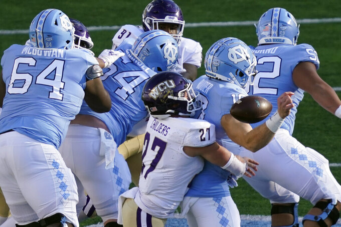 Western Carolina linebacker Trevor Childers (27) sacks North Carolina quarterback Jace Ruder (10) causing a fumble during the second half of an NCAA college football game in Chapel Hill, N.C., Saturday, Dec. 5, 2020. (AP Photo/Gerry Broome)
