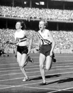 FILE - In this Dec. 1, 1956, file photo, Australia's Betty Cuthbert, right, wins the 4 x 100-meter relay final, in a new world Record time of 44.5 seconds, at Melbourne, Australia. (AP Photo/File)