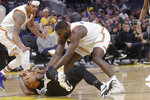 San Antonio Spurs guard DeMar DeRozan, bottom, tries to hold on to the ball under Golden State Warriors forward Eric Paschall, left, and guard Damion Lee during the second half of an NBA basketball game in San Francisco, Friday, Nov. 1, 2019. (AP Photo/Jeff Chiu)
