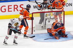 Edmonton Oilers goalie Mike Smith (41) gives up a goal as Adam Larsson (6) and Chicago Blackhawks' Dominik Kubalik (8) look for the puck during the second period of an NHL hockey playoff game in Edmonton, Alberta, Saturday, Aug. 1, 2020. (Jason Franson/The Canadian Press via AP)