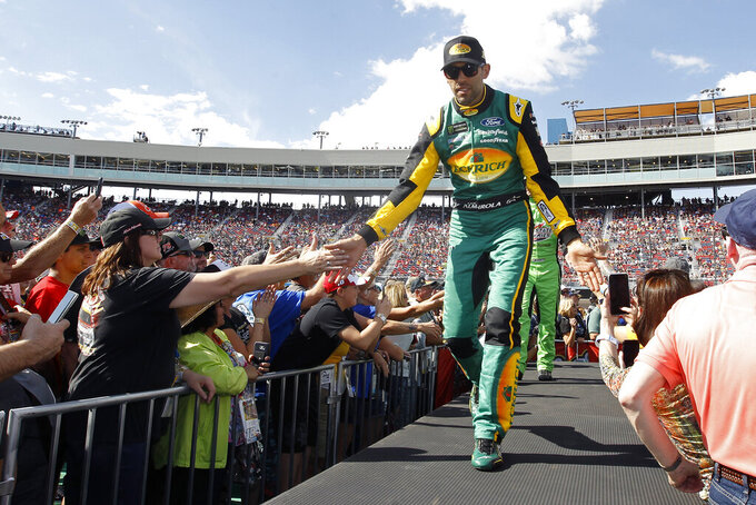 Aric Almirola greets fans during driver introductions prior to the NASCAR Cup Series auto race at ISM Raceway, Sunday, Nov. 10, 2019, in Avondale, Ariz. (AP Photo/Ralph Freso)