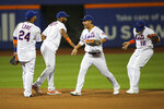 New York Mets' Robinson Cano (24), Amed Rosario (1), Michael Conforto and Juan Lagares (12) celebrate after defeating the Los Angeles Dodgers in a baseball game, Saturday, Sept. 14, 2019, in New York. (AP Photo/Mary Altaffer)