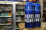 This Thursday, Jan. 10, 2019, photo shows cans of Bud Light in Washington. Starting next month, packages of Bud Light will have prominent labels showing the beer's ingredients and calories as well as the amount of fat, carbohydrates and protein in a serving.  Bud Light is likely the first of many to make the move. The labels aren't legally required, but major beer makers agreed in 2016 to voluntarily disclose nutrition facts on their products by 2020. (AP Photo/Jacquelyn Martin)