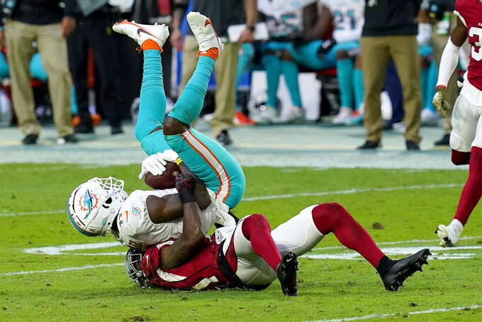 Arizona Cardinals cornerback Patrick Peterson takes Miami Dolphins wide receiver DeVante Parker, top, during the second half of an NFL football game, Sunday, Nov. 8, 2020, in Glendale, Ariz. (AP Photo/Ross D. Franklin)