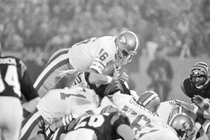 FILE - In this Jan. 24, 1982, file photo, San Francisco 49ers quarterback Joe Montana (16) sneaks across the goal line for the 49ers first score in the first quarter of Super Bowl XVI at the Pontiac Silverdome in Pontiac, Mich.  What doach Kyle Shanahan, quarterback Jimmy Garoppolo, defensive end Nick Bosa and the rest of the San Francisco 49ers are doing this year harkens back to 1981 when Bill Walsh, Joe Montana and Ronnie Lott led the franchise to its first Super Bowl title.  (AP Photo/Ray Stubblebine, File)