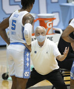 North Carolina coach Roy Williams has a word with Armando Bacot (5) during a time out in the second half of an NCAA college basketball game against North Carolina Central, Saturday, Dec. 12, 2020, at the Smith Center in Chapel Hill, N.C. (Robert Willett/The News & Observer via AP)