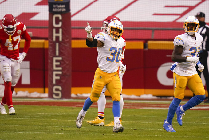 Los Angeles Chargers running back Austin Ekeler (30) celebrates after catching a 4-yard touchdown pass during the first half of an NFL football game against the Kansas City Chiefs, Sunday, Jan. 3, 2021, in Kansas City. (AP Photo/Jeff Roberson)