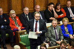 Northern Ireland's DUP (Democratic Unionist Party) deputy leader Nigel Dodds, centre, speaks during the Brexit debate inside the House of Commons in London Saturday Oct. 19, 2019.  At the rare weekend sitting of Parliament, Prime Minister Boris Johnson implored legislators to ratify the Brexit deal he struck this week with the other 27 EU leaders. Lawmakers voted Saturday in favour of the 'Letwin Amendment', which seeks to avoid a no-deal Brexit on October 31. (Jessica Taylor/House of Commons via AP)