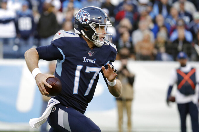 Tennessee Titans quarterback Ryan Tannehill runs 21 yards for a touchdown against the Jacksonville Jaguars in the first half of an NFL football game Sunday, Nov. 24, 2019, in Nashville, Tenn. (AP Photo/James Kenney)