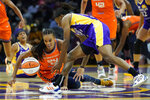 Connecticut Sun forward DeWanna Bonner (24) and Los Angeles Sparks guard Erica Wheeler (17) dive after a loose ball during the second half of WNBA basketball game Thursday, Sept. 9, 2021, in Los Angeles. (AP Photo/Ashley Landis)