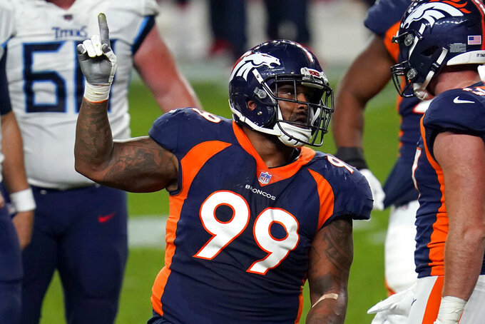 FILE - In this Monday, Sept. 14, 2020, file photo, Denver Broncos defensive end Jurrell Casey (99) gestures after a tipped pass against the Tennessee Titans during the second half of an NFL football game in Denver. The 10th-year veteran and five-time Pro Bowler tore a biceps tendon in Denver's 28-10 loss to the Tampa Bay Buccaneers on Sunday, Sept. 27, 2020. (AP Photo/David Zalubowski, File)