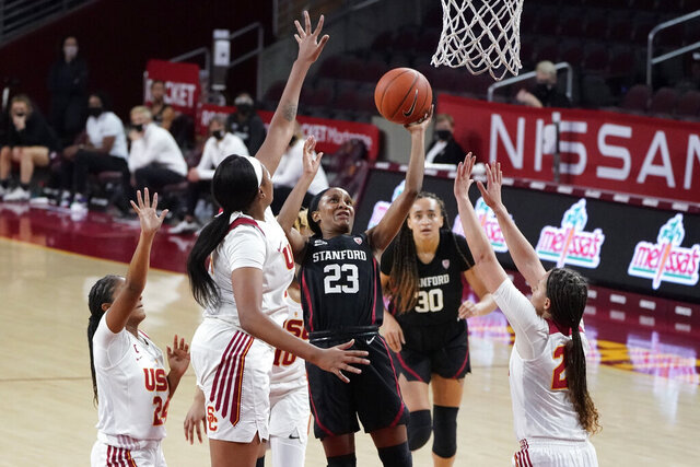 Stanford guard Kiana Williams (23) drives to the basket against Southern California during the first half of an NCAA college basketball game Saturday, Dec. 19, 2020, in Los Angeles. (AP Photo/Marcio Jose Sanchez)
