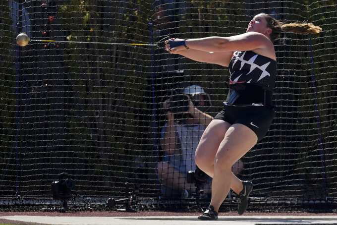 DeAnna Price reacts after sets a new American record during the finals of the women's hammer throw at the U.S. Olympic Track and Field Trials Saturday, June 26, 2021, in Eugene, Ore.(AP Photo/Ashley Landis)