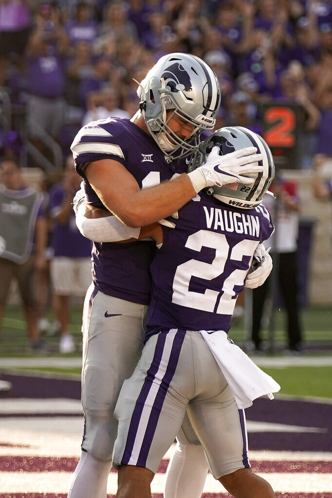 Kansas State running back Deuce Vaughn (22) celebrates with tight end Sammy Wheeler after scoring a touchdown during the first half of an NCAA college football game against Southern Illinois, Saturday, Sept. 11, 2021, in Manhattan, Kan. (AP Photo/Charlie Riedel)