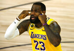 LeBron James of the Los Angeles Lakers reacts against the Oklahoma City Thunder during the second quarter during an NBA basketball game Wednesday, Aug. 5, 2020, in Lake Buena Vista, Fla. (Kevin C. Cox/Pool Photo via AP)
