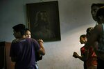 Children participate in a dance class in a parish house in the Petare shanty town, in Caracas, Venezuela, Friday, May 3, 2019. A mostly European group of nations is looking to send a high-level delegation to Caracas in the coming days to propose solutions to Venezuela's protracted crisis. (AP Photo/Rodrigo Abd)