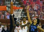 Texas guard Courtney Ramey (3) lays the ball up against Villanova forward Jeremiah Robinson-Earl (24) during the second half of an NCAA college basketball game, Sunday, Dec. 6, 2020, in Austin, Texas. Villanova won 68-64. (AP Photo/Michael Thomas)