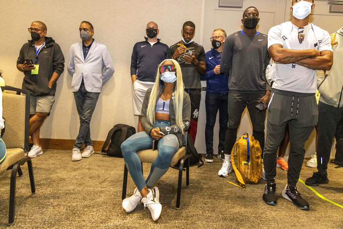 Sha'carri Richardson, seawted, attends a news conference Friday, Aug. 20, 2021, a day before competing in the 100 meters at the Pre Classic track and field meet in Eugene, Ore. (AP Photo/Thomas Boyd)