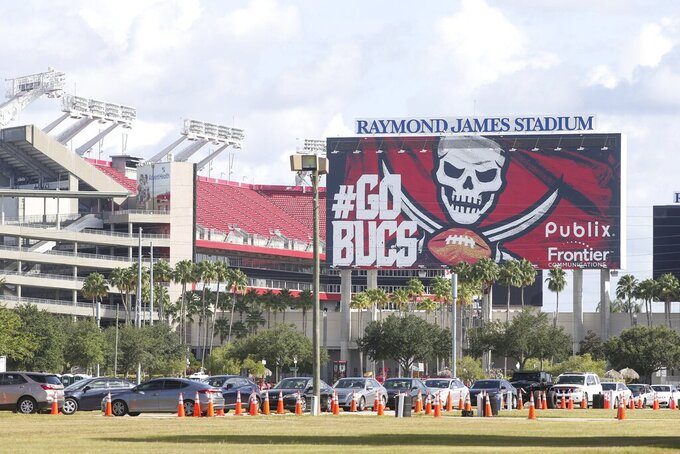 Cars line up outside Raymond James Stadium in Tampa, where the state expanded COVID-19 testing, on Tuesday, June 30, 2020. (Ivy Ceballo/Tampa Bay Times via AP)