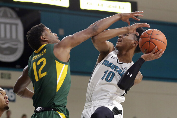 Coastal Carolina guard Tyrell Gumbs-Frater (10) drives to the basket while Baylor guard Jared Butler (12) defends during the first half of an NCAA college basketball game at the Myrtle Beach Invitational in Conway, S.C., Friday, Nov. 22, 2019. (AP Photo/Gerry Broome)