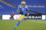 UCLA quarterback Dorian Thompson-Robinson (1) runs the ball during the second quarter of an NCAA college football game against Southern California, Saturday, Dec 12, 2020, in Pasadena, Calif. (AP Photo/Ashley Landis)