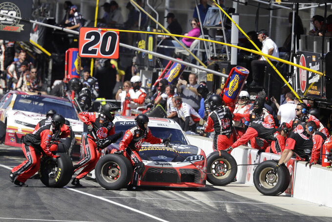 NASCAR Xfinity Series driver Christopher Bell makes a pit stop during the NASCAR Xfinity auto race at the Indianapolis Motor Speedway, Saturday, Sept. 7, 2019 in Indianapolis. (AP Photo/Darron Cummings)