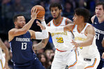 Dallas Mavericks guard Jalen Brunson (13) looks to make a pass as Golden State Warriors' Marquese Chriss (32) and Jordan Poole, right, defend in the first half of an NBA basketball game in Dallas, Wednesday, Nov. 20, 2019. (AP Photo/Tony Gutierrez)