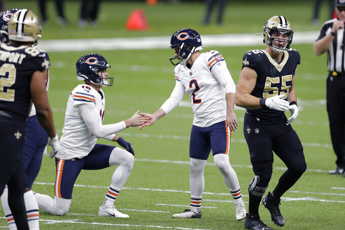 Chicago Bears holder Pat O'Donnell (16) congratulates kicker Cairo Santos (2) after his field goal in the first half of an NFL wild-card playoff football game against the Chicago Bears in New Orleans, Sunday, Jan. 10, 2021. (AP Photo/Brett Duke)