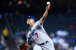 Los Angeles Dodgers starting pitcher Julio Urias throws against the Arizona Diamondbacks during the first inning of a baseball game Sunday, Sept. 26, 2021, in Phoenix. (AP Photo/Ross D. Franklin)