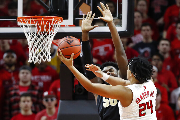 Rutgers guard Ron Harper Jr. (24) shoots around Purdue forward Trevion Williams (50) during the first half of an NCAA college basketball game Tuesday, Jan. 28, 2020, in Piscataway, N.J. (AP Photo/Kathy Willens)