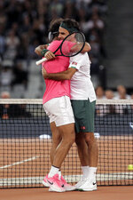 FILE - In this Feb. 7, 2020, file photo, Roger Federer, right, and Rafael Nadal embrace after the final point of their exhibition tennis match held at the Cape Town Stadium in Cape Town, South Africa. (AP Photo/Halden Krog, File)