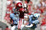 Oklahoma wide receiver Marvin Mims (17) makes a catch ahead of Tulane safety Derrion Rakestraw (13) during a NCAA college football game Saturday, Sept. 4, 2021, in Norman, Okla. (AP Photo/Alonzo Adams)