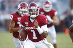 Oklahoma quarterback Jalen Hurts (1) carries in the second quarter of an NCAA college football game against South Dakota Saturday, Sept. 7, 2019, in Norman, Okla. (AP Photo/Sue Ogrocki)