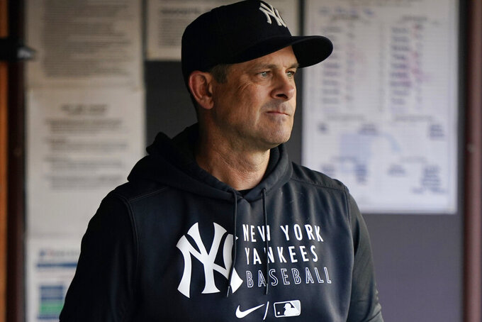 New York Yankees manager Aaron Boone is shown in the dugout before a baseball game against the Boston Red Sox, Sunday, June 6, 2021, at Yankee Stadium in New York. (AP Photo/Kathy Willens)