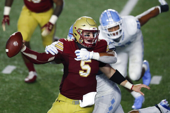 North Carolina linebacker Jeremiah Gemmel, behind, tries to take down Boston College quarterback Phil Jurkovec (5) during the second half of an NCAA college football game, Saturday, Oct. 3, 2020, in Boston. (AP Photo/Michael Dwyer)