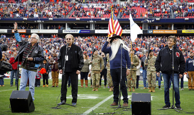 The Oak Ridge Boys perform the national anthem before the Music City Bowl NCAA college football game between Purdue and Auburn Friday, Dec. 28, 2018, in Nashville, Tenn. (AP Photo/Mark Humphrey)