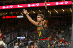 Atlanta Hawks guard Trae Young (11) reacts to a referee in the first half of an NBA basketball game against the Indiana Pacers, Friday, Dec. 13, 2019, in Atlanta. (AP Photo/Brett Davis)
